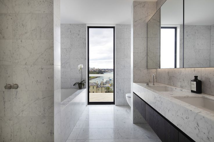 I love the space this bathroom offers, everything has its own place. The marble is too much for me.