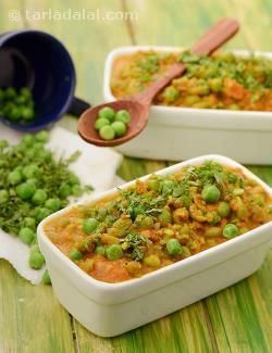 Green peas ambti is a classic maharashtrian preparation of coarsely crushed peas and tomatoes. It uses a rich and spicy masala paste that is to be freshly prepared with onions, coconut and a traditional selection of spices.