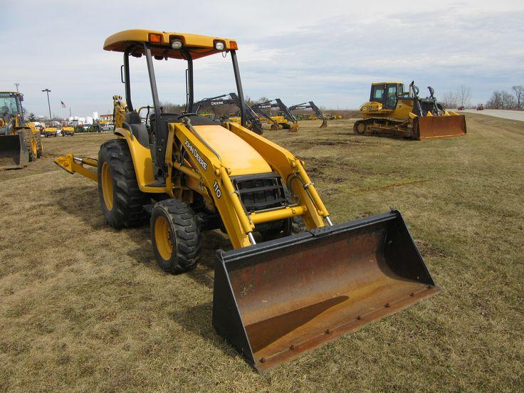 John Deere 110 backhoe with 950J  bulldozer in background