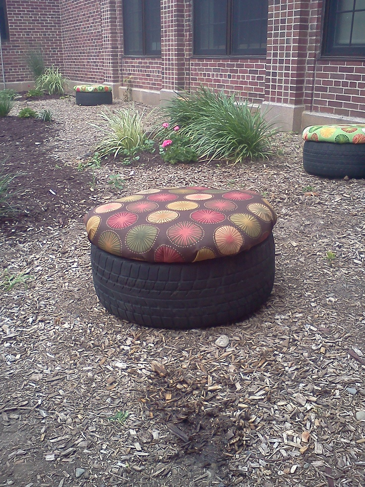 """Recycled tire seat for outdoor classroom. Treated plywood,  2 inch foam, clear vinyl then covered with outdoor fabric. All stapled underneath. Screwed 3 little """"legs"""" to bottom of plywood that sit down in the tire like a plug of sorts. This keeps the seat top in place. Stinking adorable!"""