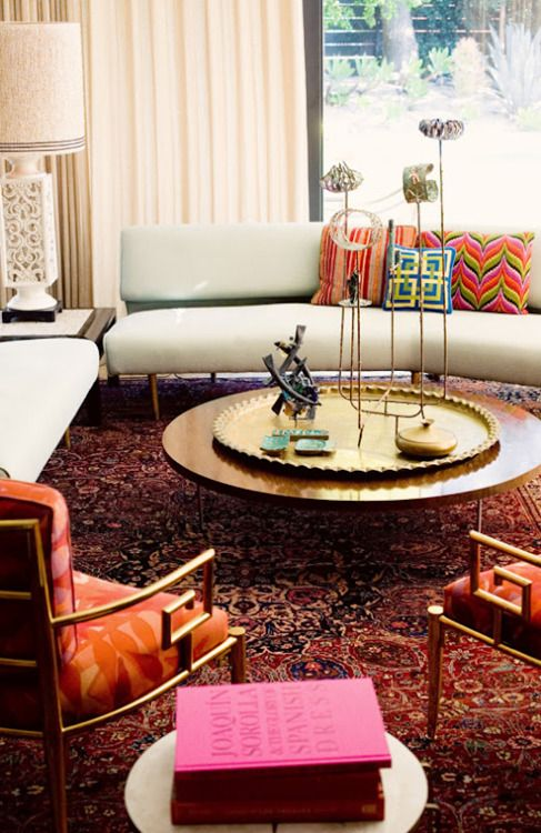 The use of mid century modern pieces in this room looks fresh and new because of the bright colors and fabric choices.