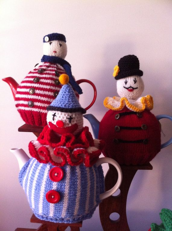 This tea pot cosy is designed and hand knitted by the shop owner making your teapot cosy individual and rather special. As such it makes a perfect gift for someone special and will brighten up any tea occasion. FIT This cosy has a knitted base that allows for plenty of stretch to fit over your teapot easily and will fit over a variety of shapes. If you are concerned about the fit over your teapot please contact me and I will ask you for some measurements from your own teapot. Pictured ov...