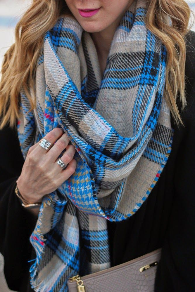 Plaid blanket scarves are the it layer for fall. Add one to any look for extra color and volume.