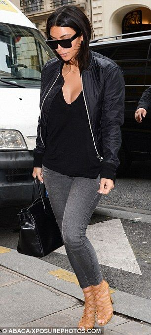 Kim Kardashian arrives in Paris for Fashion Week in jeans and a black bomber jacket http://dailym.ai/1ok5qz1
