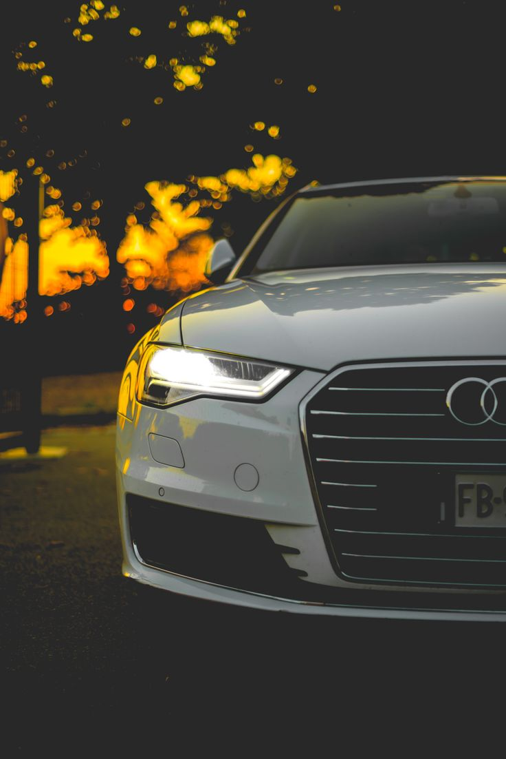 The Right Side Headlight Of A White Audi