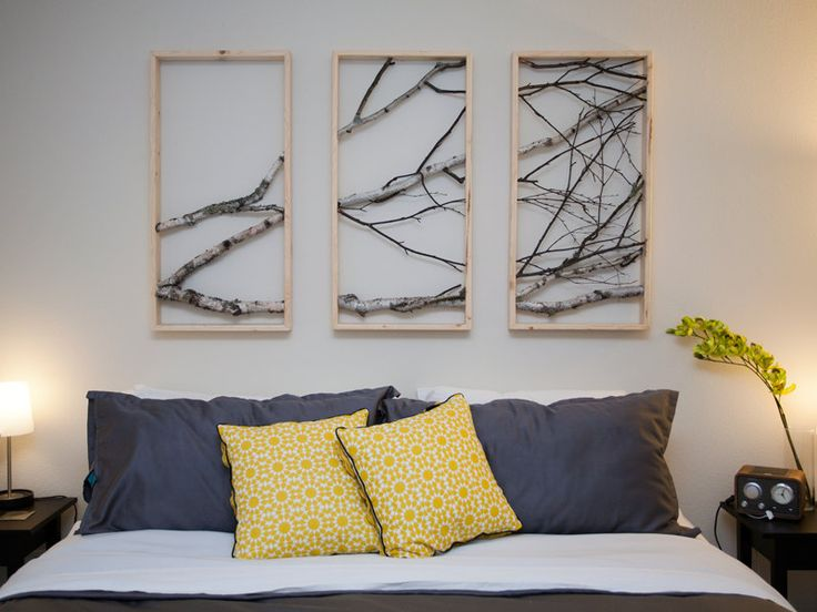 Bring a little nature into the bedroom with framed tree branches More