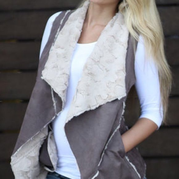 Beige faux vest Beige faux vest with pockets. Like new, worn only one time. Sebby Collection Jackets & Coats Vests