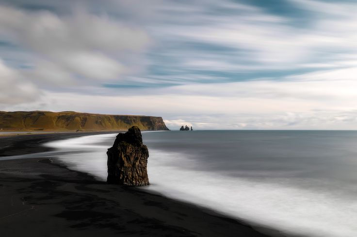Black Swan - Dyrholaey is located in South Coast of Iceland very close to Vik town. Its famous for black sand beaches. Loved clicking it from high vantage point.