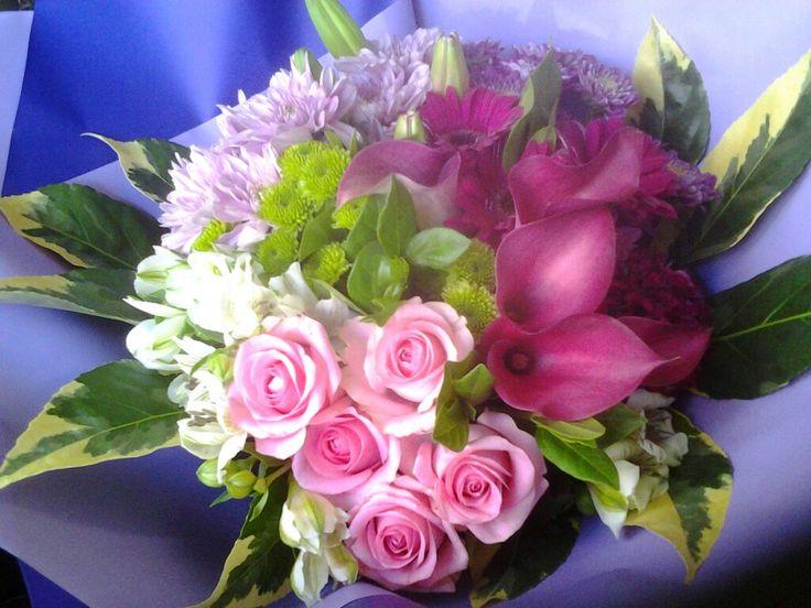 Pink roses, Zantedetia(Cala lilies) mix. Rosemary Florist