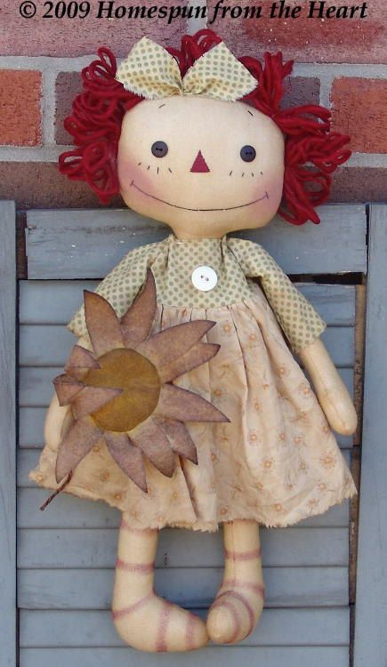 Primitive Raggedy Ann Doll With Daisy pattern. $5,50, via Etsy.