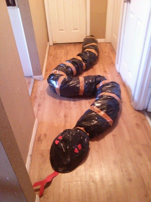 Getting ready for Halloween ...outside decoration gaint snake..made out of trash bags and duct tape