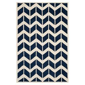 Add interest to your bedroom or study floor with this hand-tufted wool rug, featuring a bold chevron design. Team with monochrome décor for maximum impact.   Product: RugConstruction Material: WoolColour: Dark blue and ivoryFeatures: Hand-tufted  Pile Height: 1.6 cm Note: Please be aware that actual colours may vary from those shown on your screen. Accent rugs may also not show the entire pattern that the corresponding area rugs have.Cleaning and Care: Vacuum regularly