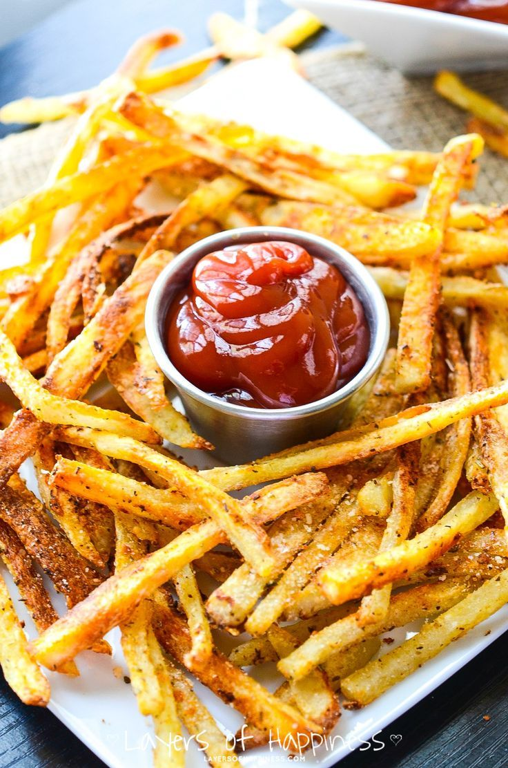 Extra Crispy Oven Baked French Fries Peel and slice, then soak potatoes in water for 30 min. Rinse and dry. Line on parchment paper and toss with 1-2 tablespoons of oil and seasoning. Bake at 400 deg for 30 min (flipping once), Then turn up to 425 deg and bake til ends are brown.