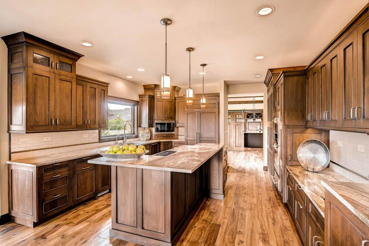 love the rich brown cabinets not too dark and the cabinet design. Contemporary Rustic Kitchen | HGTV