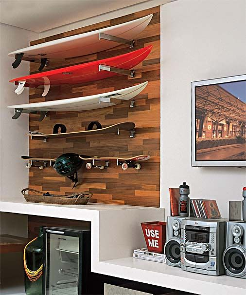 Skateboards and surfboards as a wall feature and a way to store them