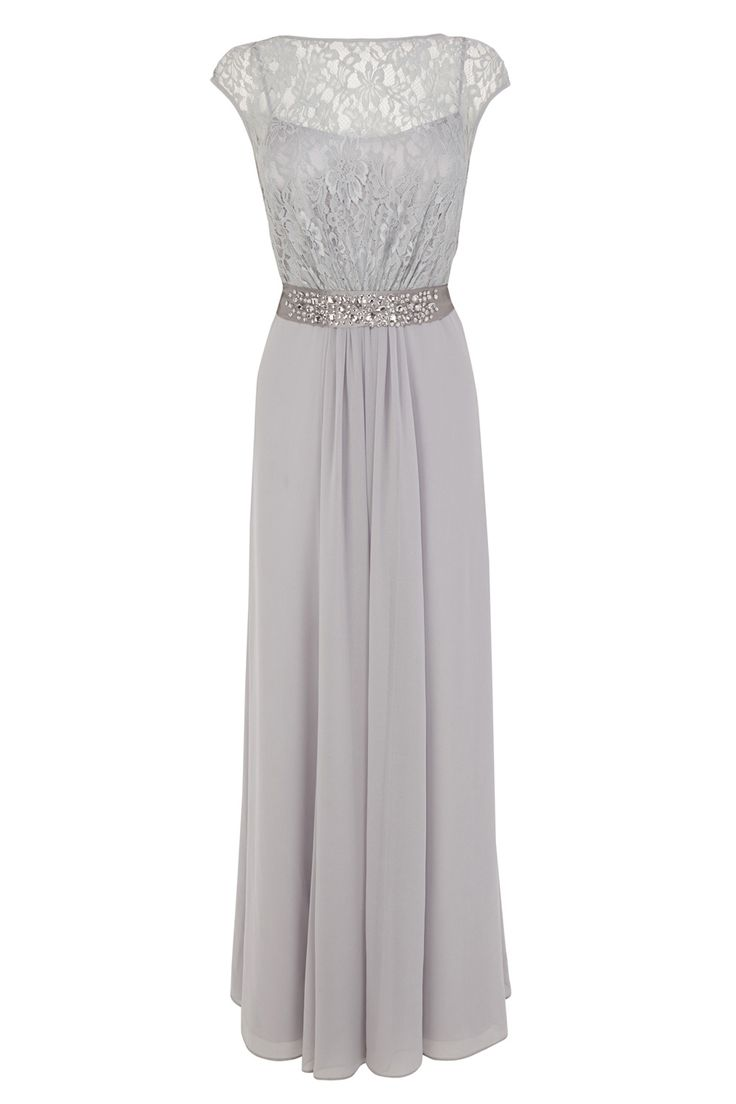 A truly sumptuous maxi gown perfect for any extra special occasion. The Lori Lee Maxi Dress features a sheer bodice lined with a soft slip for a demure and feminine allure. The waist is cinched with a lustrous waist tie embellished with faux gems for an opulent aesthetic. The back of the dress features a graceful keyhole detail and the skirt is fully lined for party perfect movement. Dress length from underarm to hem is 128cm/50.5 inches. Height of model shown: 5ft 9inches/175cm. Model…