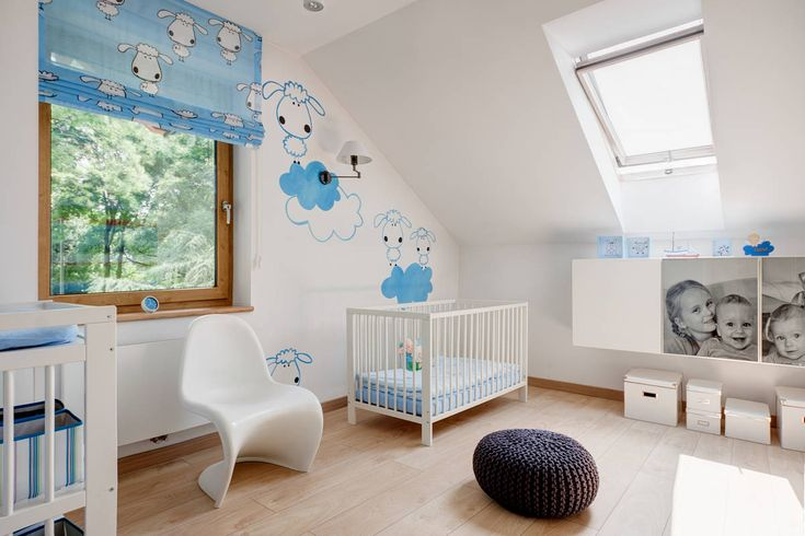 Nursery with White Crib and White Cair near Wide Window