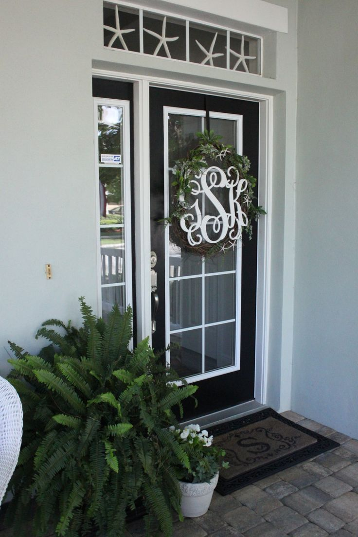 448 best coastal decorating ideas images on pinterest coastal a monogrammed wreath ferns and white flowers for the entrance at starfish cottage find this pin and more on coastal decorating ideas