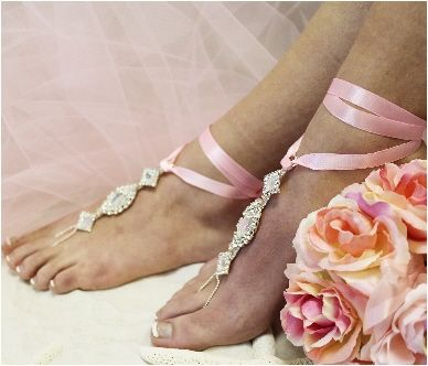Feel enchanted wearing our rhinestone barefoot sandals with pink satin ribbon for your fairy tale beach wedding. As perfect as true love's first kiss. Enchanted bridal foot jewelry, the pink satin rib