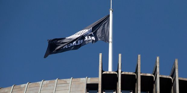 The All Blacks flag flying from the Beehive before their Victory Parade from Parliament through the streets of Wellington. Photo / Mark Mitchell
