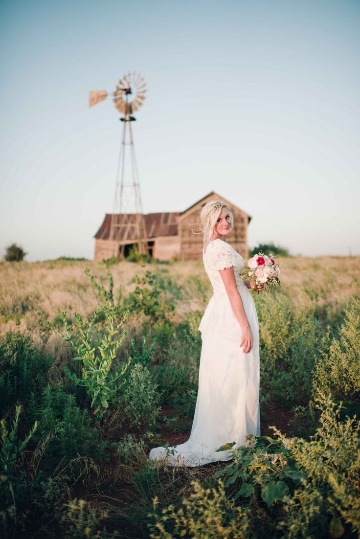 A Beautiful Bride Stands In Front Of An Old Homestead Oklahoma Photos By Hibben Barn Wedding VenueBarn