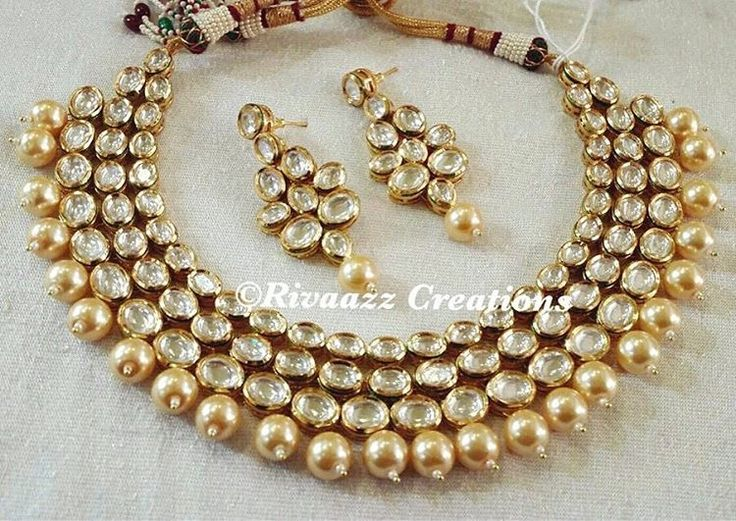 Beautiful gold and champagne kundan and pearl choker set by Rivaazz Creations.