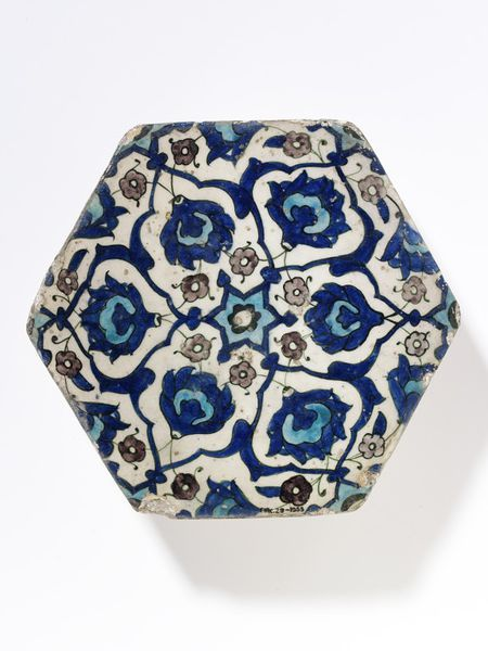 Tile | Made in Damascus, Syria, 16th century | Materials: fritware, polychrome underglaze painted, glazed | Tile of white fritware, hexagonal, painted with an interlace pattern of flowers and rosettes in blue, turquoise, purple and outlined with green under a clear glaze | VA Museum, London