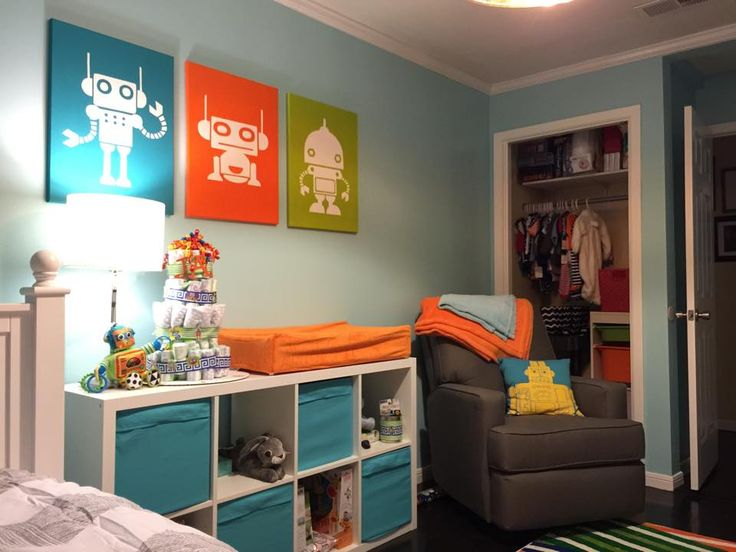 I decided on baby bot nursery because I'd never done art for a robot nursery before. I settled on 4 main colors: turquoise, lime green, orange and navy.