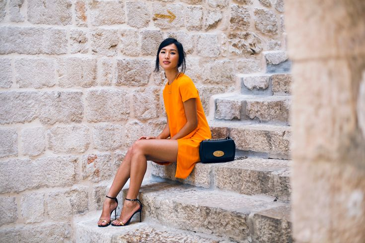 LOCATION: DUBROVNIK Camilla and Marc Dress / Carolina Herrera Heels / Mulberry Bag / Mania Mania Ring / Jennifer Zeuner Ring