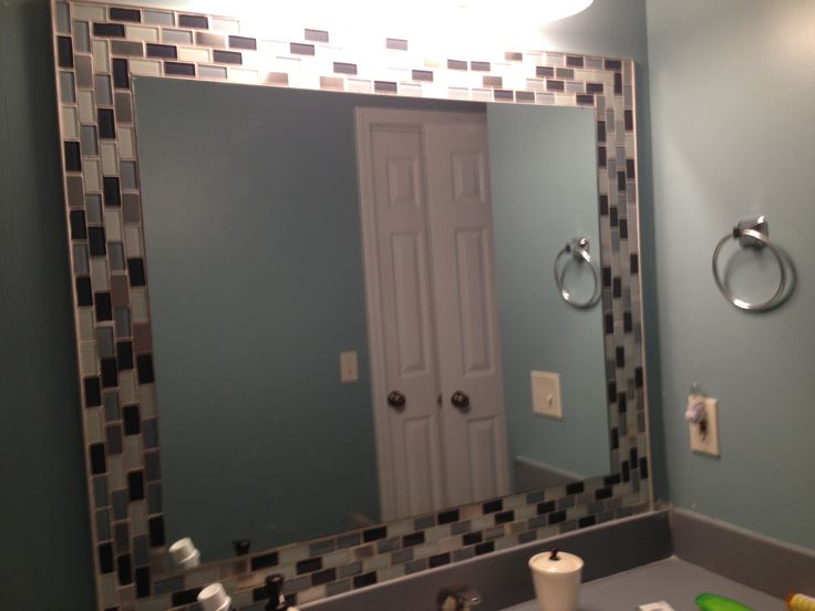 Glass tiles around mirror! Jazzes up any bathroom! So easy!