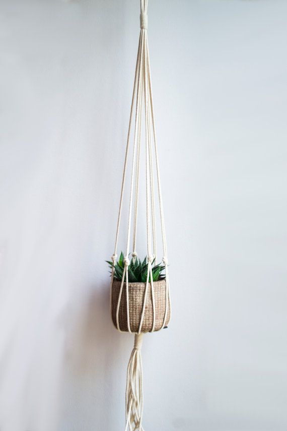 This handmade and beautiful macrame plant hanger is made of a ecru colored natural cotton cord. The cotton cord is made of natural fibers and is 1/8
