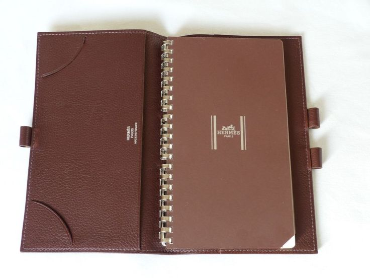 NEW Hermes AGENDA NOTEBOOK COVER - NOTEPAD & 925 SILVER PEN. Silver pen has a removable cap and produces a fine line in blue ink. It is engraved 925, Hermes, Made in France on shaft. Pen has been cleaned.