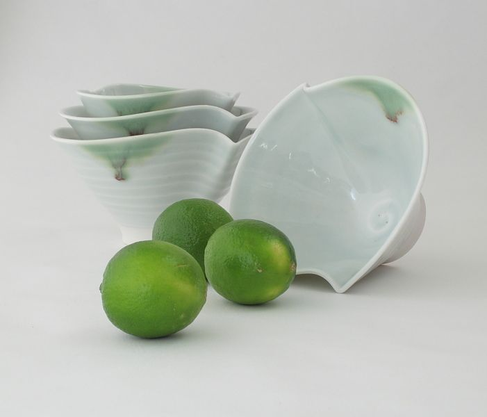 """Hand thrown porcelain 3 bowls with graduated size made from high quality """" Ming"""" porcelain glazed with celadon glaze. Microwave and dishwasher safe. http://www.marketdirect.ie/porcelain-wave-collection-trio-of-bowls"""