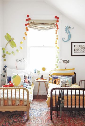 """Purchasing a toddler bed can seem like a waste of money (Do I really have to buy a transitional bed?), but using one saves so much floor space, it's worth it,"" says Gabrielle Stanley Blair, author of Design Mom: How to Live With Kids: A Room-by-Room Guide."