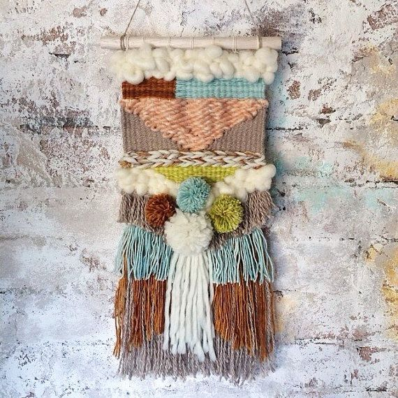 1 medium size handmade weaving wall hanging made from high quality hand spun yarns. Colours are light blue, cream, bronze, like green and