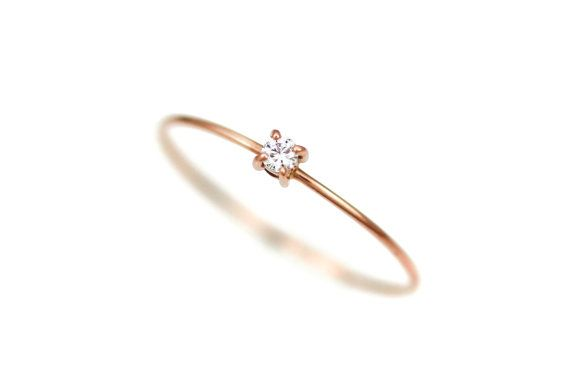 Metal : 14k solid gold (available in Yellow gold, Rose gold, or White gold) - Gemstone : Genuine clear white diamond / Carat:0.03ct(2mm), Color:F-G, Clarity:SI1 - Width : 0.6mm Bliss J Birthstone Collection is just as unique as you. The simple design of Bliss J birthstone jewelry rebounds to the sparkling hue of each birthstone. The smooth surface of Bliss J birthstone 14k gold ring shines on your hand. For centuries, colored stone each month is thought to bring good luck and health to...