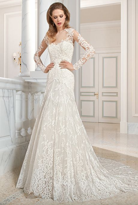Brides: Demetrios - Couture. This classic all lace, a-line gown features a high illusion neckline and long sheer sleeves with lace appliques. The keyhole illusion back features a delicate scalloped lace edging with button closure and chapel train.