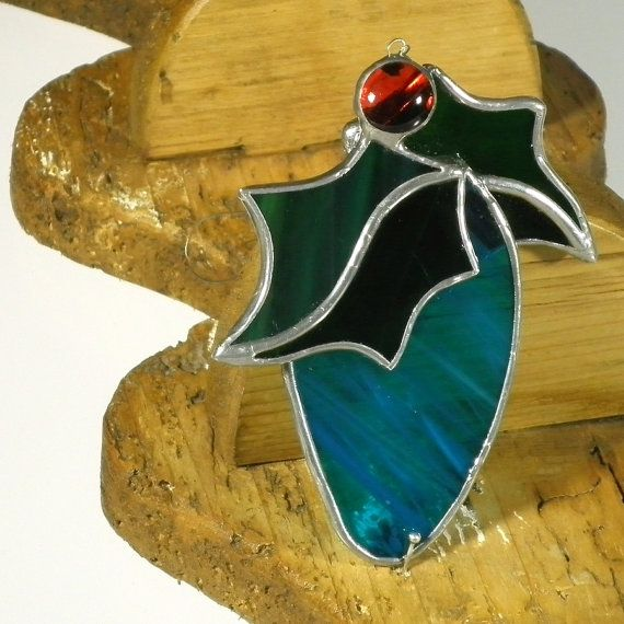 This three dimensional stained glass Christmas ornament has been made using the Tiffany method from high quality stained glass. It can be window ornament, or can be used as a beautiful wall hanging.  All decoration measures approximately 2.7in per 3.6in (7x9 cm). It is hanging on a tiger tail wire. The solder is well polished for extra shine.  All our small ornaments are gift packed, ready to become a lovely present for someone special. Do not hesitate to contact me if you have any further…