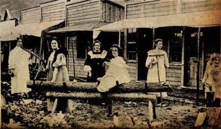 """Six of Dawson City's """"good-time girls,"""" or prostitutes, posing for a photograph, ca. 1900. Dawson City Museum & Historical Society"""