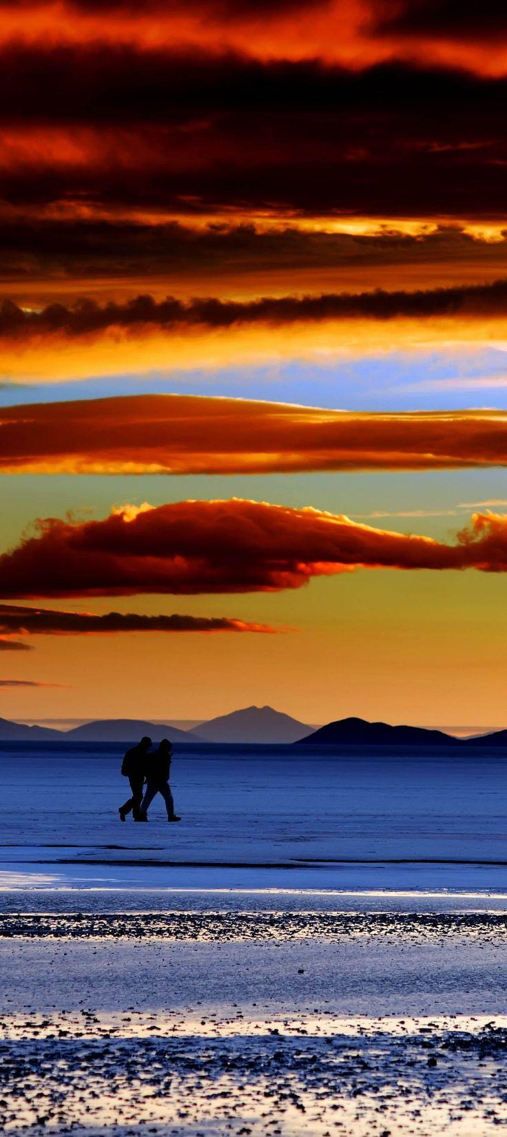 fiery sunset over the Salar de Uyuni in Bolivia.