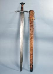 Espada de San Mauricio (de Turín). Hacia 1200-1250. Se trata de una de las dos espadas atribuidas a San Mauricio (la otra forma parte de las Insignias del Sacro Imperio Romano Germánico). Proviene de la Abadía de Saint-Maurice-d'Agaune (Suiza). Adquirida por los Duques de Saboya en 1591. Armería Reale di Torino Inv. nº  G25.  http://www.artito.arti.beniculturali.it:81/Armeria%20Reale/Percorsi/html/col_item.php?i=02=02=_en