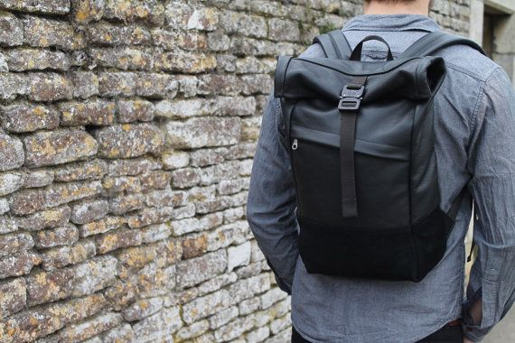 Black leather backpack with rolltop, Leather and Suede rolltop backpack, Leather Rolltop Backpack with padded laptop sleeve ______________________________________________________________________________________  The Saxby Rolltop mixes our Motto black leather with super soft suede detailing. Each pack features an AustriAlpin COBRA buckle, the class leader used by special forces worldwide.  Liberal use of closed cell foam results in a comfortable carry even when fully loaded. Internally a…