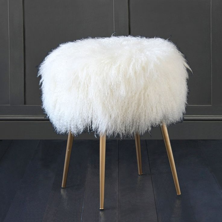 white fur chair with gold legs