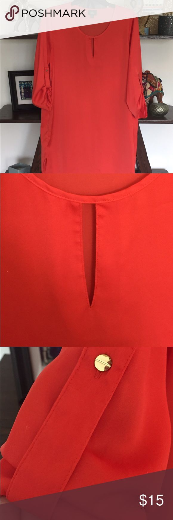 Bright Red Tunic/Dress Red tunic dress. Can be worn straight as a shift style dress or with a belt to be more fitted. 3/4 length sleeves with button loop (can be unattached). Small V cutout in front and rounded hem line. EUC only worn once Mossimo Supply Co Tops Tunics