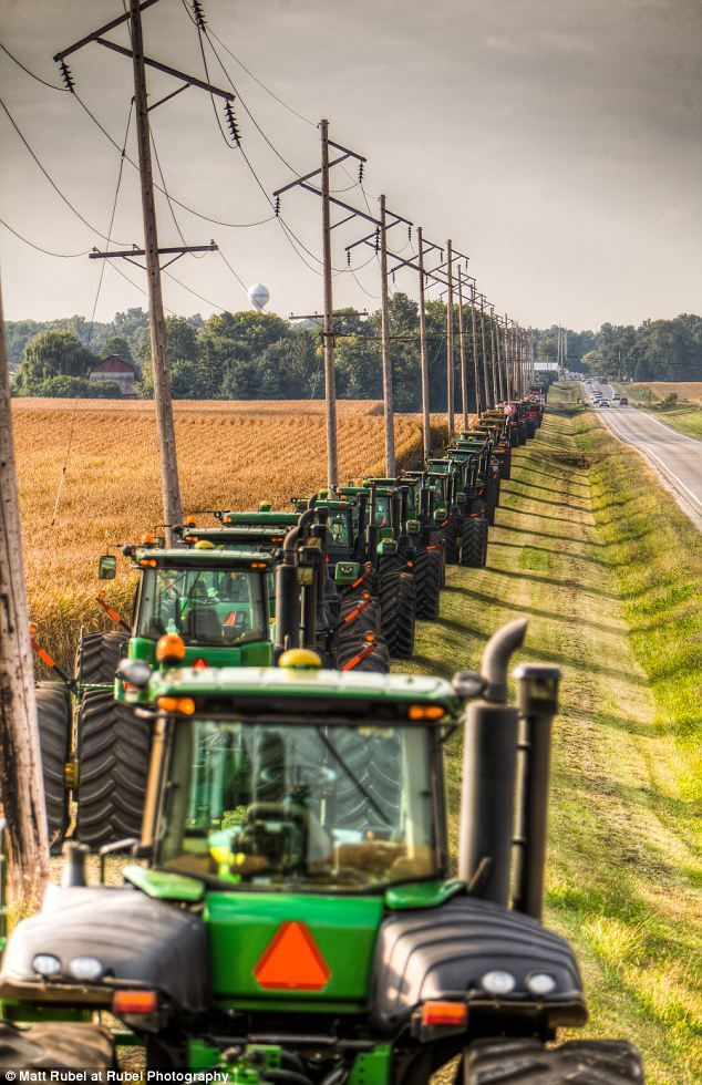 Tribute: Over 60 tractors and other items of farming machinery were lined up along the road in tribute to Kyle Hendrix, who died of cancer a...
