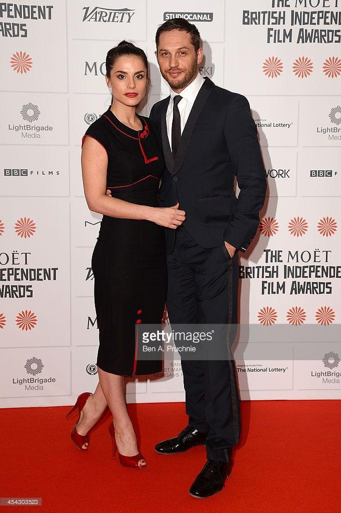 Actors Tom Hardy and Charlotte Riley arrive on the red carpet for the Moet British Independent Film Awards at Old Billingsgate Market on December 8, 2013 in London, England.