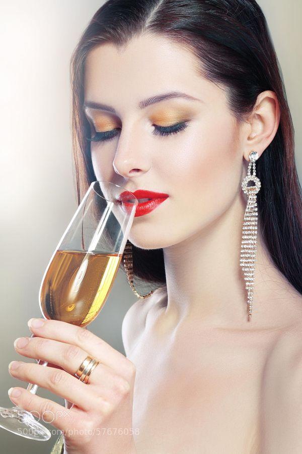 woman in hold a glass by OlenaZaskochenko