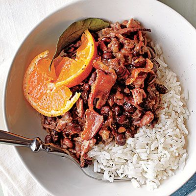 Looking to try something new in the kitchen? Slow Cooker Brazilian Feijoada is a delicious stew of pork and black beans that's traditionally served over rice with fresh orange slices. #CrockPot #SlowCooker #Recipes