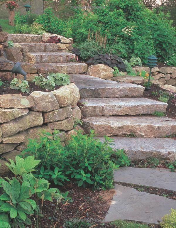 Landscaping St. Louis, natural stone steps, boulder retaining walls, and landscaping.