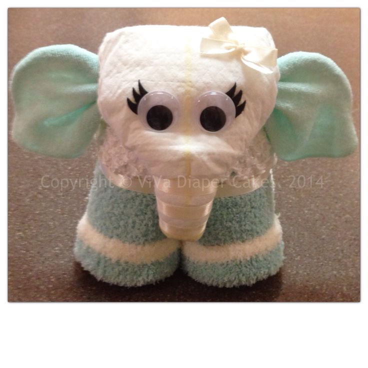 Turquoise and white elephant diaper cake. Diaper animals make perfect toppers for any diaper cake or made to stand alone. Tutorial coming soon.